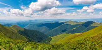 Gorgeous panorama of mountains on fine summer day. Fluffy clouds on a blue sky Stock Photo