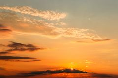 Gorgeous panorama scenic of the strong sunset with clouds on the orange sky.  royalty free stock photos
