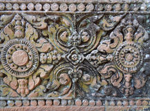 Gorgeous pattern of the medieval carved stone wall in Prasat Hin Phanom Rung Ancient Khmer Temple, Buriram Stock Photos
