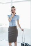 Gorgeous peaceful businesswoman phoning while standing in her office Stock Image