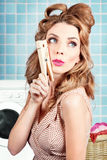 Gorgeous pin-up woman holding large cleaning peg Stock Photos