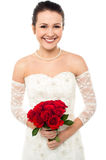 Gorgeous pretty bride with a rose bouquet Royalty Free Stock Photo