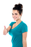 Gorgeous pretty girl showing thumbs up to you Royalty Free Stock Image