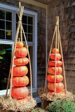 Gorgeous pumpkins stacked in pots Stock Photography