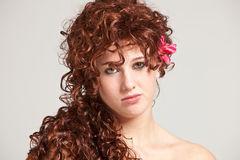 Gorgeous readhead. Beautiful young woman with long red hair looking serious Stock Photos