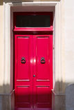 Gorgeous red british house door at house on Malta Stock Images
