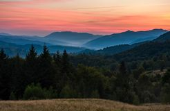 Gorgeous red dusk in forested mountain landscape Stock Photography