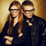 Gorgeous red-haired fashion twins in trendy eyewear Stock Images