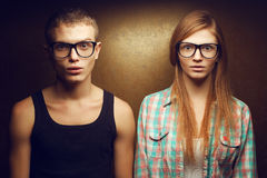 Gorgeous red-haired (ginger) fashion twins in eyewear Royalty Free Stock Image