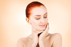 Gorgeous red haired model portrait with skin surgery mark isolat Stock Photo