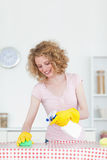 Gorgeous red-haired woman cleaning a cutting board Stock Images