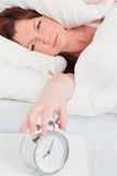 Gorgeous red-haired woman waking up Stock Images