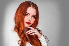 Gorgeous redhead girl. Photoshot of gorgeous redhead girl with bright makeup stock image