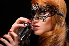 Gorgeous redhead singer Stock Photography