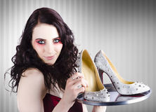 Gorgeous retail fashion girl selling luxury shoes Stock Images