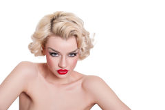 Smouldering retro blond vamp Royalty Free Stock Image