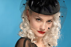 Gorgeous retro girl in forties hat with feathers. Gorgeous retro girl in authentic forties black hat with feathers Stock Photo