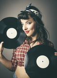 Gorgeous retro pin up girl posing with records Stock Photography