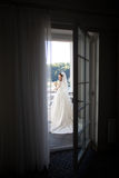 Gorgeous romantic bride in white dress and veil posing at hotel balcony.  stock photos