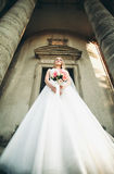 Gorgeous romantic gentle stylish beautiful caucasian bride on the background ancient baroque castle Stock Photography