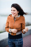 Gorgeous Romantic Girl Outdoors. Long Hair Blowing in the Wind. Selective focus. Stock Photography