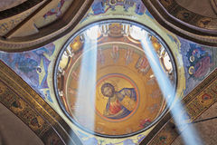 Gorgeous round arch ceiling lit by the sun. Gorgeous round arch ceiling lit by two bright rays of the sun. On the ceiling in the Hall of the Holy Sepulchre image Stock Image