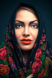 Gorgeous russian woman in shawl. Gorgeous young russian woman in shawl , on blue Stock Photography
