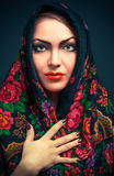 Gorgeous russian woman in shawl. Gorgeous young russian woman in shawl , on blue Royalty Free Stock Image