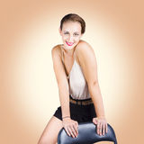 Gorgeous 1950s house wife posing on chair Royalty Free Stock Photo
