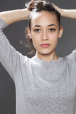 Gorgeous 20s mixed-race girl smiling with natural beauty Stock Images