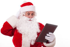 Gorgeous Santa Claus is acknowledging with modern Royalty Free Stock Image
