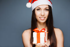 Gorgeous santa girl. Gorgeous cheerful santa girl on gray Stock Images