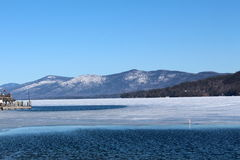 Icy water and mountain range Stock Images