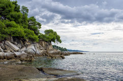 Gorgeous scenery by the sea under a cloudy sky in Sithonia, Chalkidiki, Greece Royalty Free Stock Image