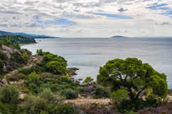 Gorgeous scenery by the sea under a cloudy sky in Sithonia, Chalkidiki, Greece Stock Image