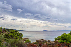 Gorgeous scenery by the sea under a cloudy sky in Sithonia, Chalkidiki, Greece Stock Photo