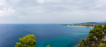 Gorgeous scenery by the sea under a cloudy sky in Sithonia, Chalkidiki, Greece Royalty Free Stock Photo