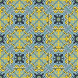 Gorgeous seamless patchwork pattern from  blue and yellow Moroccan tiles, ornaments. Stock Photo