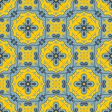 Gorgeous seamless patchwork pattern from  blue and yellow Moroccan tiles, ornaments. Royalty Free Stock Photography
