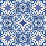 Gorgeous seamless patchwork pattern from dark blue and white Moroccan, Portuguese  tiles, Azulejo, ornaments. Royalty Free Stock Photo