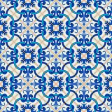 Gorgeous seamless patchwork pattern from dark blue and white Moroccan, Portuguese  tiles, Azulejo, ornaments. Stock Photos
