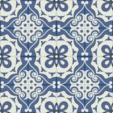 Gorgeous seamless patchwork pattern from dark blue and white Moroccan tiles, ornaments. Royalty Free Stock Photography