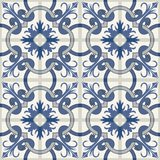 Gorgeous seamless patchwork pattern from dark blue and white Moroccan tiles, ornaments. Stock Images