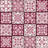 Gorgeous seamless patchwork pattern from dark red and white Moroccan tiles, ornaments. Royalty Free Stock Image