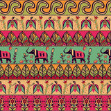 Gorgeous seamless pattern in the bohemian style. Tribal print with hand drawn elements, such us birds, elephants, flowers, leaves, and more. Repeating ethnic vector illustration