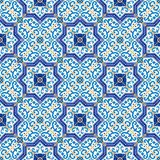 Gorgeous seamless  pattern from dark blue and white Moroccan, Portuguese  tiles, Azulejo, ornaments. Stock Photos