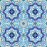Gorgeous seamless  pattern from dark blue and white Moroccan, Portuguese  tiles, Azulejo, ornaments. Stock Photo