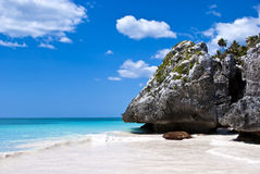 Gorgeous secluded Beach in Tulum Mexico. A beach paradise in Tulum, Mexico. Turquoise water and deep blue sky Stock Photo
