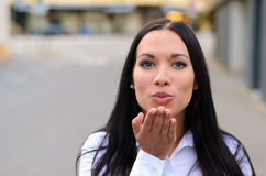 Gorgeous seductive woman blowing a kiss Royalty Free Stock Photography