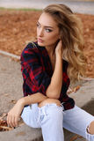 Gorgeous sensual woman with blond hair in casual clothes Stock Images
